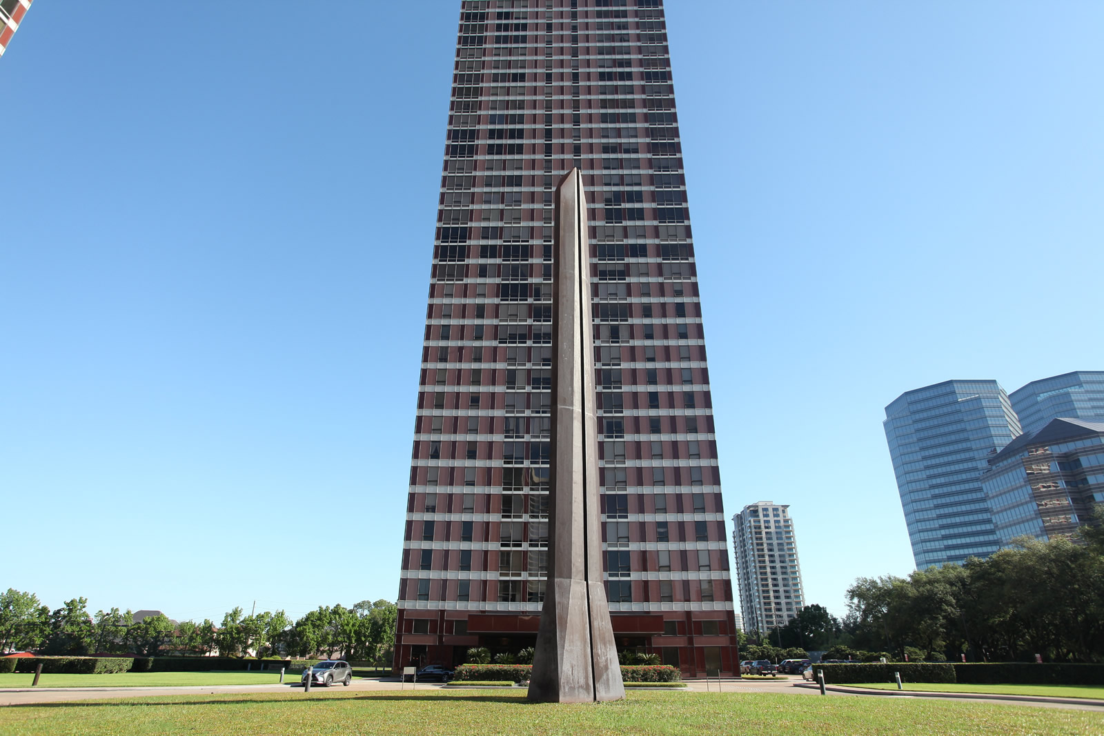 high-rise tower with metal sculpture